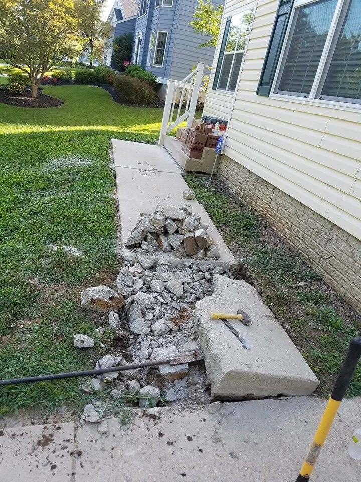 Removing the old sidewalk.