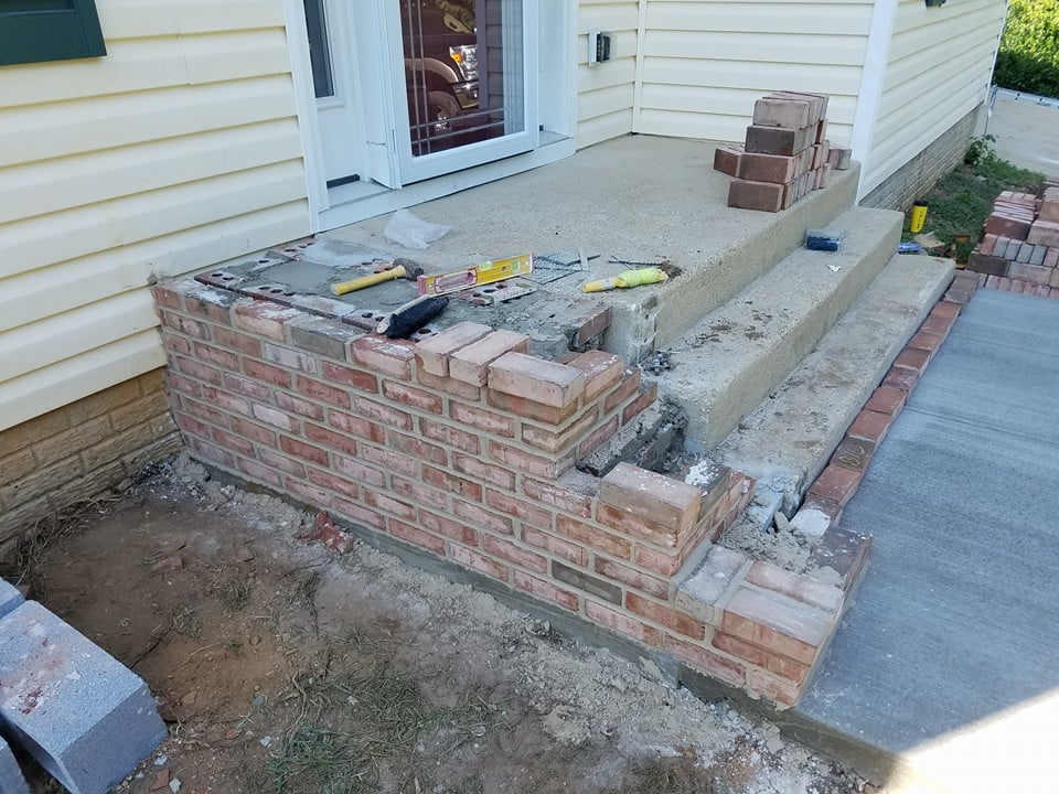 Widening the existing steps with bricks.