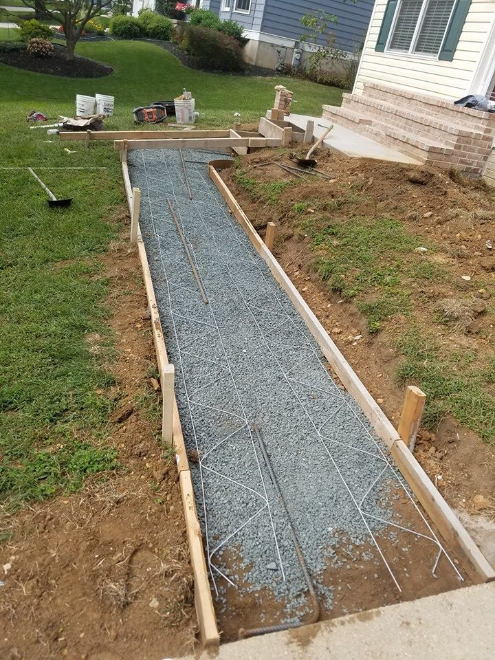 Framing & preparing the new sidewalk area for concrete pour.